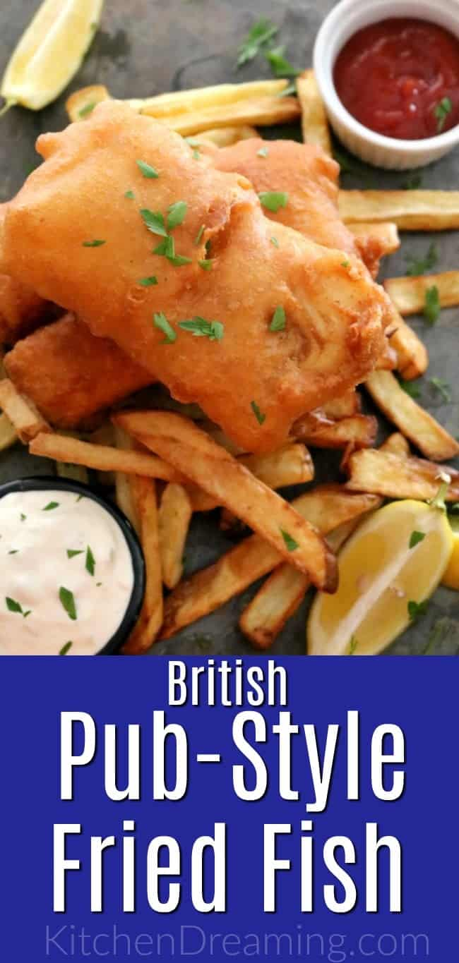 A plate of British Pub-style Fried Fish, Savory, golden brown, beer-battered cod fillets served with french fries, coleslaw, lemon wedges, and tangy tartar sauce. #British #PubFood #GlobalStreetFood #FriedFish #30MinuteMeals #KitchenDreaming