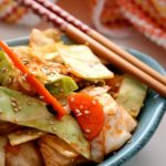 Ready in as little as 15-minutes, this quick Korean kimchi is delicious unfermented but may be left to ferment as well. Starting with Korean Gochujang paste and common green cabbage, this marinated kimchi is as quick as it is flavorful. #Kimchi #Korean #Cabbage #Easy #Maangchi #YangbaechuKimchi #KitchenDreaming
