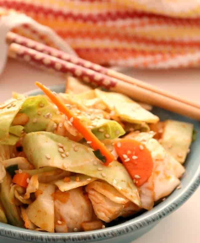 Ready in as little as 15-minutes, this quick Korean kimchi is delicious unfermented but may be left to fermented as well. Starting with Korean Gochujang paste and common green cabbage, this marinated kimchi is as quick as it is flavorful. #Kimchi #Korean #Cabbage #Easy #Maangchi #YangbaechuKimchi #KitchenDreaming