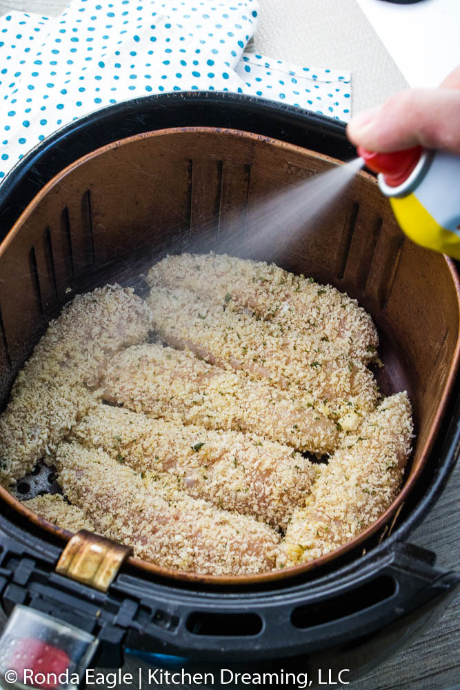 Spray the tenders with non-fat cooking spray.