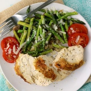 Oven Baked Chicken plated with asparagus