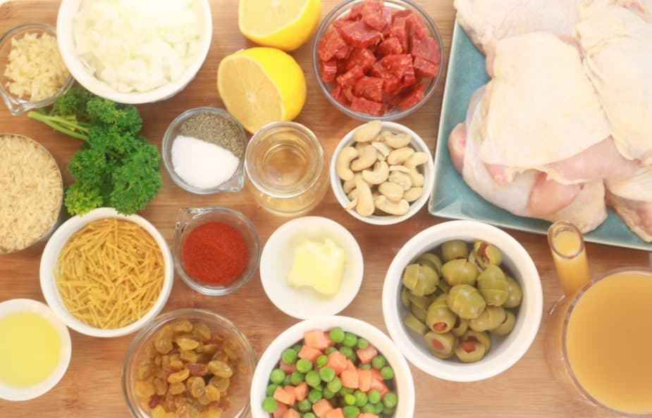 An overhead shot of the ingredients of one pot chicken and spanish style rice pilaf.
