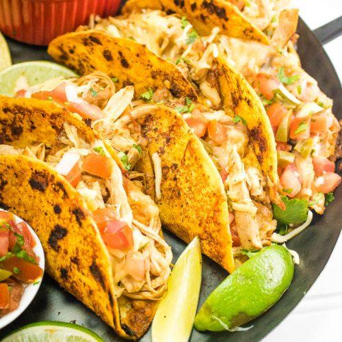 A tray of chicken birria tacos